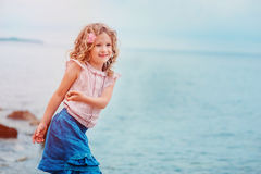 Happy child girl on seaside on summer vacation Royalty Free Stock Images