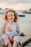 Happy child girl on seaside on summer vacation Stock Photography