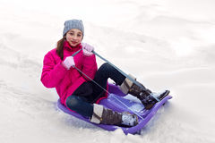 Happy child girl skate sled ride Stock Photography