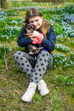 Happy child girl with small dog Stock Photography