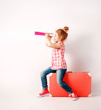 Happy child girl with spyglass, explore and adventure concept Royalty Free Stock Image