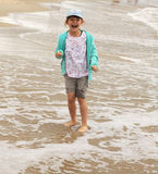 Happy child - a girl standing on the joy of the se Stock Photography