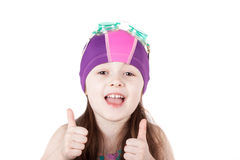 Happy child girl in swimming cap isolated on white background. Portrait of happy child girl in pool swimming cap isolated on white background. gesture of OK royalty free stock images