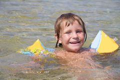 Happy child girl swimming in water Stock Image