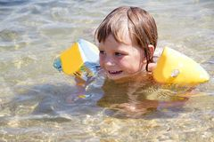 Happy child girl swimming in water Royalty Free Stock Photography