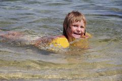Happy child girl swimming in water Stock Photo