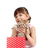 Happy child girl takes cat out gift box. Isolated on white background Royalty Free Stock Photography