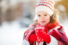 Happy child girl with tea on winter. Happy child girl with hot tea on winter walk Stock Photos