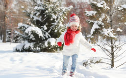 Happy child girl to run, play and enjoy on  winter walk Stock Photos