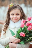 Happy child girl on warm winter forest walk, soft toned Royalty Free Stock Photos