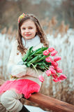 Happy child girl on warm winter forest walk, soft toned Stock Photos