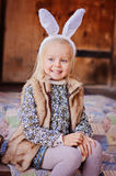 Happy child girl wearing bunny ears for easter Stock Photos