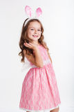 Happy child girl is wearing pink bunny ears Stock Photography