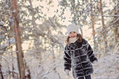 Happy child girl in winter snowy forest stock images