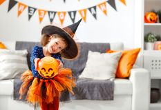 Happy   child girl in witch costume to halloween Stock Photo