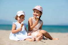 Happy Child Girls Eating Ice Cream at Beach in Summer royalty free stock photo