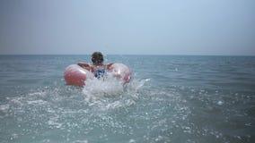 Happy child going to swim in blue sea.