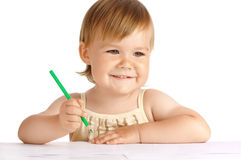 Happy child with green crayon Royalty Free Stock Photography