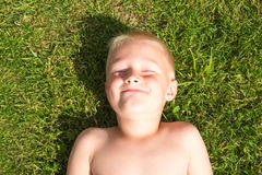 Happy child on green grass Stock Images