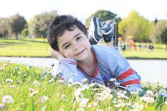 Happy child on the green in the park. Happy and smilling boy  on the green grass Royalty Free Stock Photography