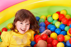Happy child in group colourful ball. Stock Photos