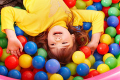 Happy child in group colourful ball. Stock Images