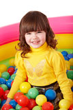 Happy child in group colourful ball. Royalty Free Stock Images
