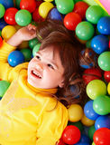 Happy child in group colourful ball. Stock Image