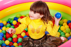 Happy child in group colourful ball. Royalty Free Stock Image