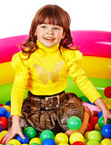 Happy child in group colourful ball. Royalty Free Stock Photography