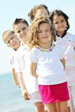 Happy child group playing  on beach Stock Photography