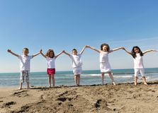 Happy child group playing  on beach Stock Image