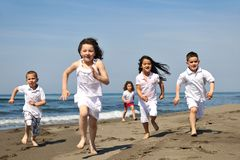 Happy child group playing  on beach Royalty Free Stock Photos