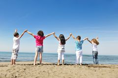 Happy child group playing  on beach Royalty Free Stock Image