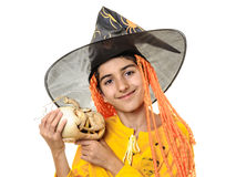 Happy child in Halloween outfit with jack-o-lantern Royalty Free Stock Photography