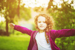 Happy child hand up, enjoying freedom at sunset. Freedom concept Stock Photography