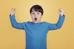 Happy child with hands in the air screaming royalty free stock photography