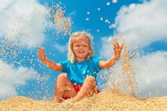 Happy child have a fun with grains crop Royalty Free Stock Photo