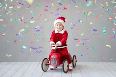 Happy child having fun on Christmas time royalty free stock photography