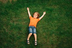 Happy little boy of 4-5 years old playing with colorful balloons royalty free stock image