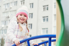 Happy child having fun on the playground Royalty Free Stock Photos