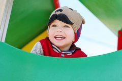 Happy child having fun on the playground Royalty Free Stock Images