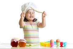 Happy child having fun preparing a pie Stock Photography