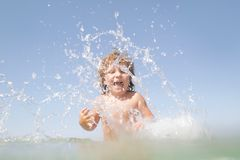 Happy child having fun in water Royalty Free Stock Photos