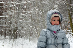 Happy child having fun in winter forest Stock Images