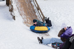 A happy child is heading to ice mountain for tubing in children Stock Photo