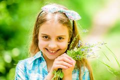 Happy child hold wildflowers. Natural beauty. Childhood happiness. summer vacation. Green environment. little girl and. Flower bouquet. wildflowers. Spring royalty free stock image