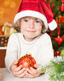 Happy Child Holding Ball Stock Images
