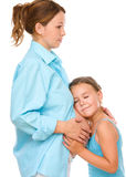 Happy child holding belly of pregnant woman Royalty Free Stock Photography