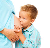Happy child holding belly of pregnant woman Stock Images